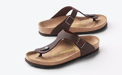 51929efb6ee0 A pair of Havana oiled Gizeh style Birkenstock sandals on a white  background.